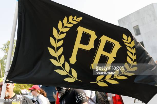 Flag of the Proud Boys, a far-right neo-fascist organization, is seen as Donald Trump supporters and heavily-armed âProud Boysâ, a far-right...