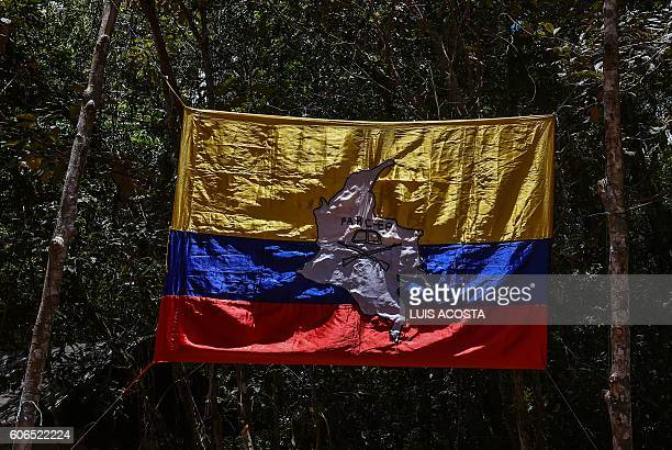 Flag of the Revolutionary Armed Forces of Colombia is seen at the camp in Llanos del Yari, Caqueta Department, Colombia, on September 16, 2016 ahead...