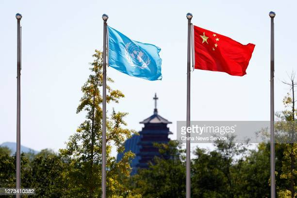 Flag of the United Nations and China fly at the Peacekeeping Center of the Ministry of National Defense on September 17, 2020 in Beijing, China.