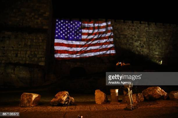 Flag of the United States is reflected by Israeli authorities on western parts of the historical walls around the Old City of Jerusalem ahead of the...