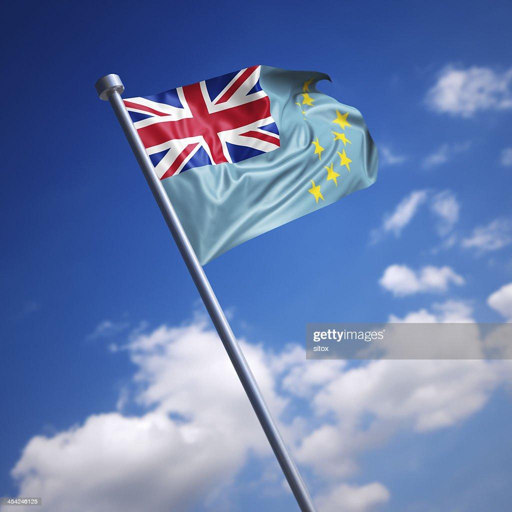 Flag of Tuvalu against blue sky : Stock Photo