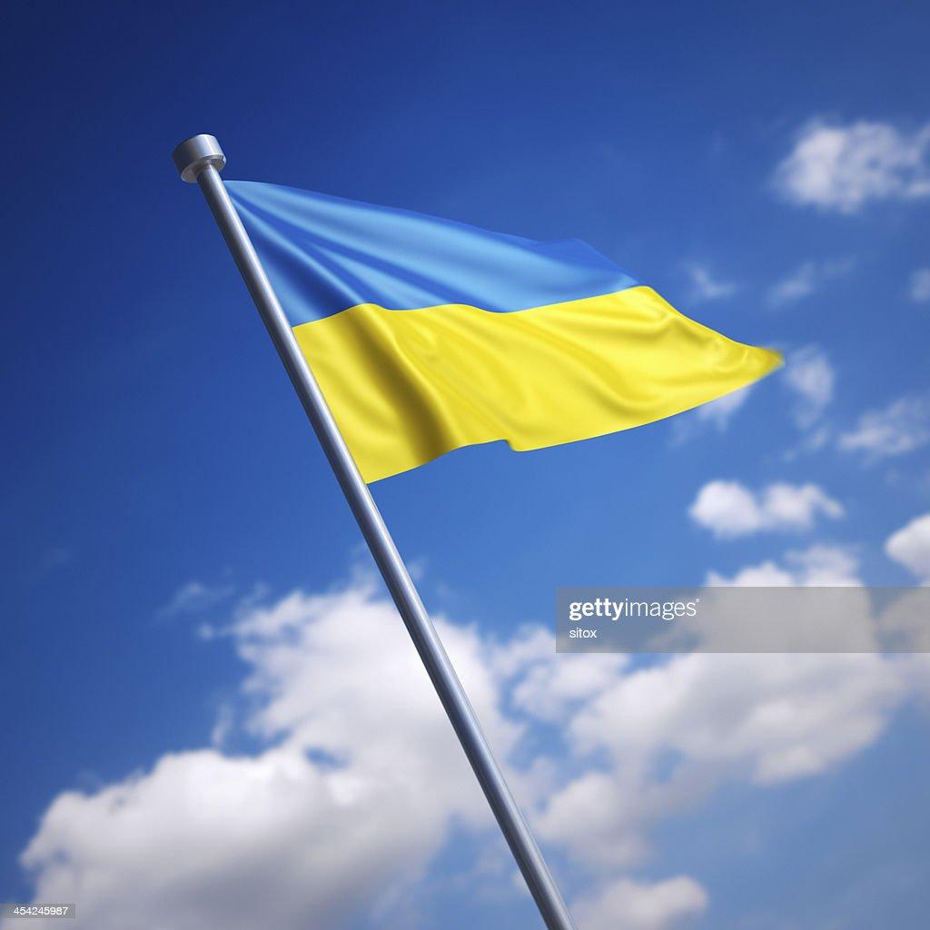 Flag of Ukraine against blue sky : Stock Photo