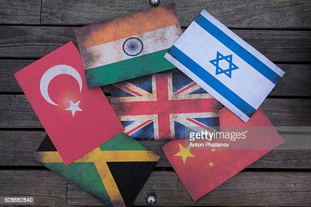 Flag of United Kingdom surrounded by flags of Israel, China, India, Jamaica, Turkey