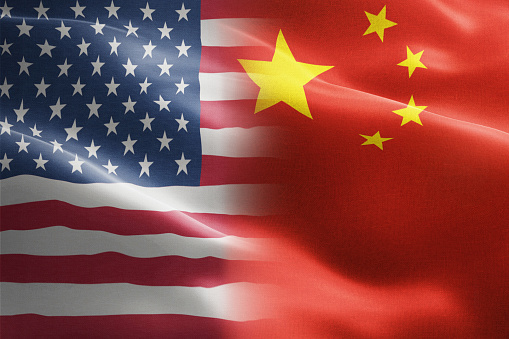 Flag of United States of America against China - indicates partnership, agreement, or trade wall and conflict between these two countries 1128952311