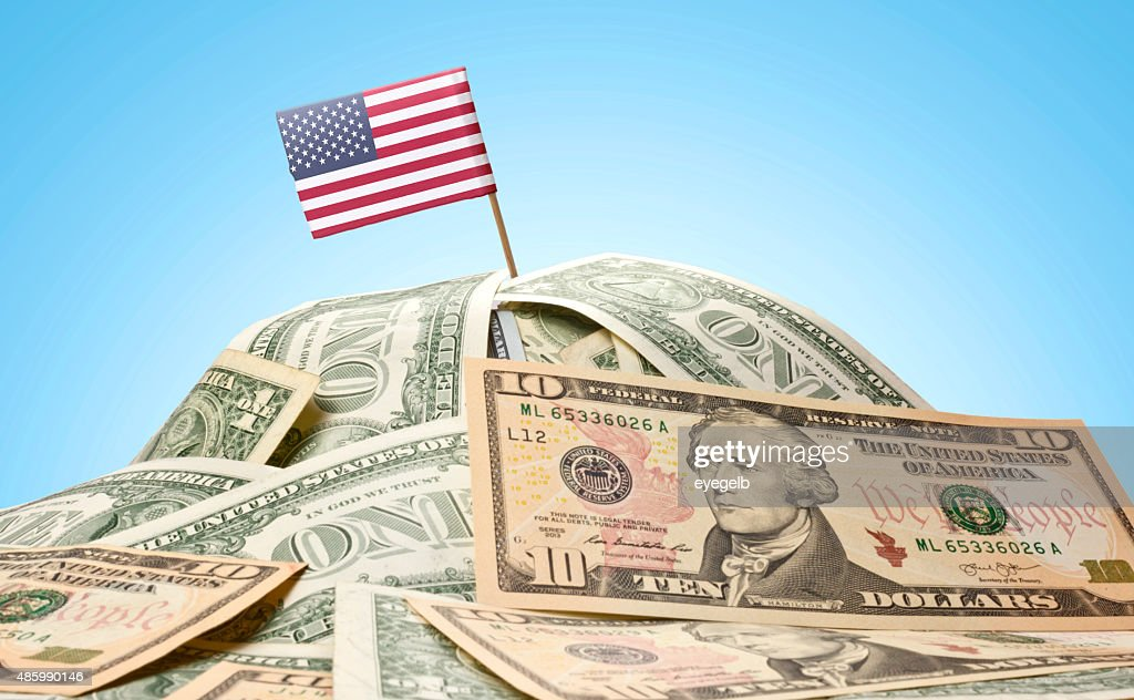 Flag of USA sticking in american banknotes.(series) : Stock Photo