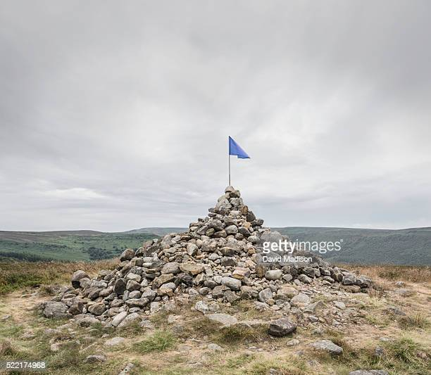 Flag on rock pinnacle