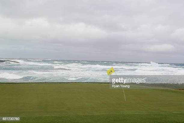 A flag on the 13th green leans in the wind during the first round of The Bahamas Great Exuma Classic at Sandals Emerald Reef Course on January 8 2017...