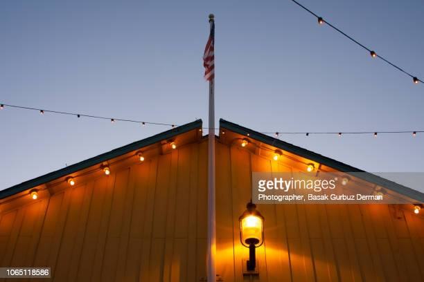 usa flag on the roof of a building - basak gurbuz derman stock photos and pictures