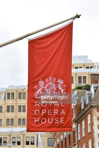 Flag on the Royal Opera House in London. Britains performing art sector is facing ruin without urgent government investment, 98 actors, directors,...