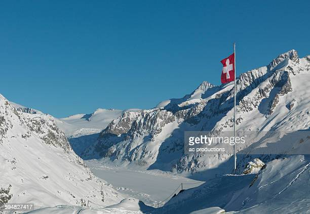 Flag over snowy slopes in remote mountains