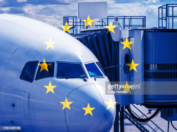 eu flag overlaying aeroplane plane cockpit scene. concept piece showing eu banning uk flights, travel, transportation and cargo from entering their countries - prime minister stock pictures, royalty-free photos & images