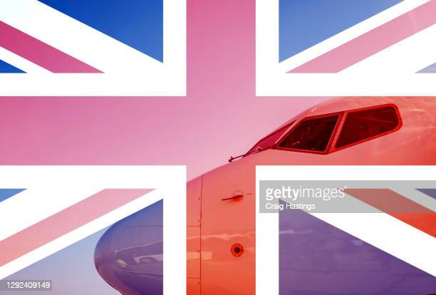 uk flag overlaying an aeroplanes cockpit. concept piece showing eu banning uk flights, travel, transportation and cargo from entering their countries - prime minister stock pictures, royalty-free photos & images
