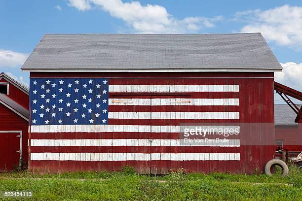 usa flag painted on red barn - eric van den brulle stock-fotos und bilder