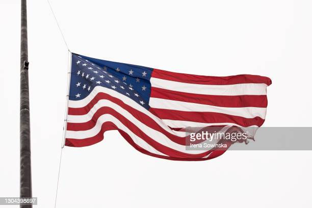 us flag - half mast stock pictures, royalty-free photos & images