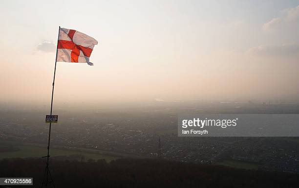 A flag pole flying a St George flag on the top of Eston Nab a local landmark overlooking Teesside shows a campaign sign supporting the UK...