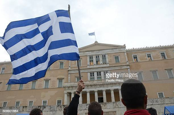 A flag raise during demonstration against pension reforms in GreeceFarmers from all over Greece demonstrate in Syntagma Square in Athens against the...