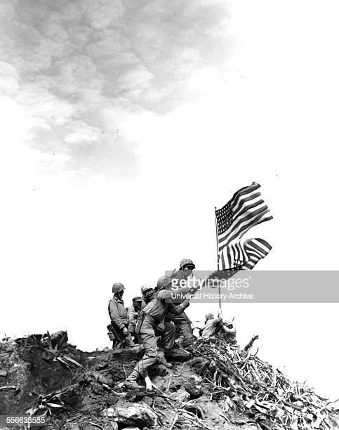 Flag raising on Iwo Jima Installing large flag on Mt Suribachi