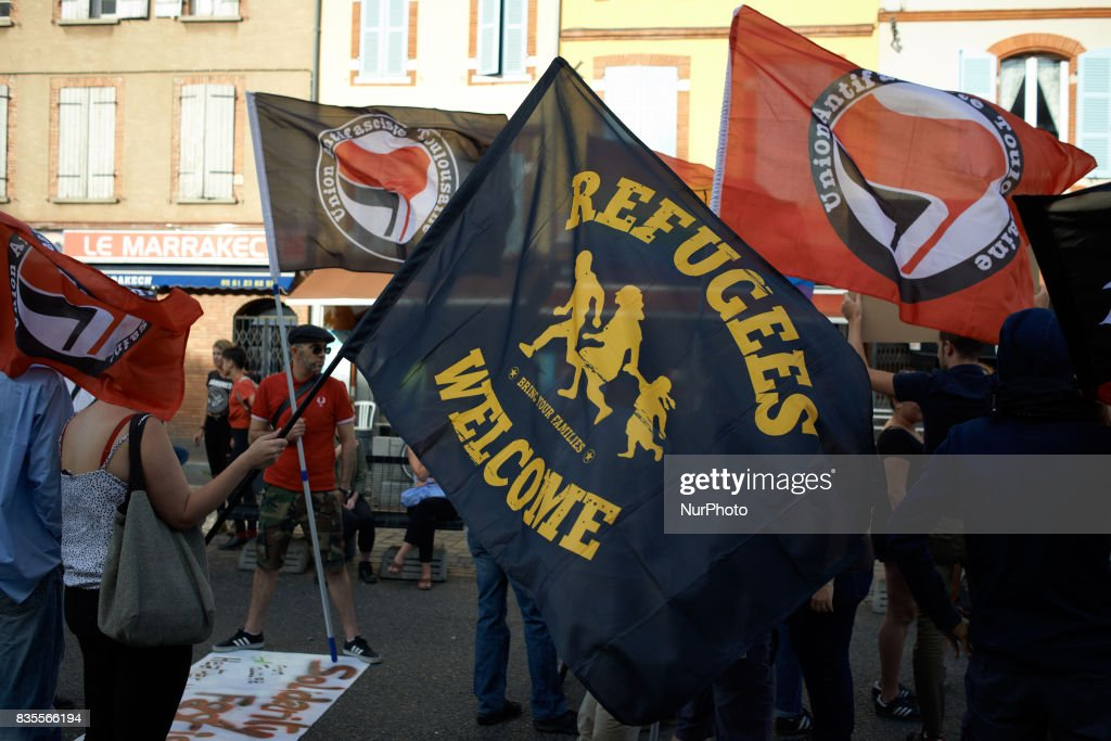 A flag reading 'Refugees Welcome' during a gathering in Toulouse in solidarity with anti-fascists in Charlottesville after the killing of Heather Heyer by a white supremacist. On August 19th 2017 in Toulouse, France.