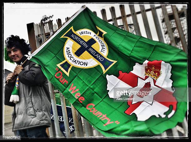 A flag seller is seen outside Windsor Park prior to the FIFA 2014 World Cup Group F Qualifier match between Northern Ireland and Russia at Windsor...