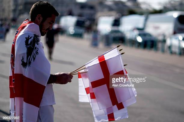 A flag seller on the promenade prior to the 2018 FIFA World Cup semi final match between Croatia and England at the Luna Beach Cinema on Brighton...