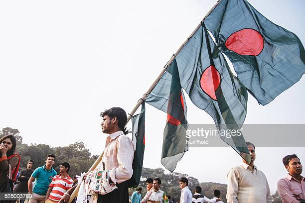A flag seller selling Bangladesh's national flag during a rally to mark the country's Victory Day in Dhaka on December 16 2015 Bangladesh won...