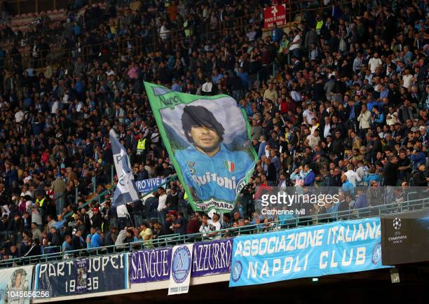 Flag showing Diego Maradona is displayed during the Group C match of the UEFA Champions League between SSC Napoli and Liverpool at Stadio San Paolo...