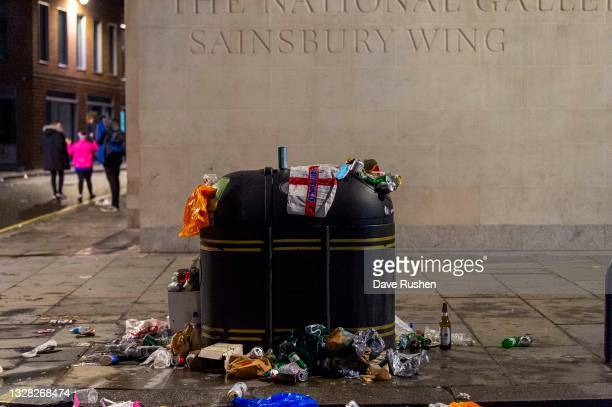 Flag sits on top of an overflowing bin on July 12, 2021 in London, England. Italy's men's team claimed victory over England in the UEFA EURO 2020...