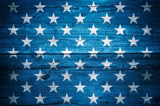 USA flag stars on vintage wood planks background 976446818