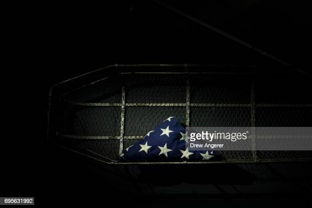 A flag used at the closing ceremony of Ground Zero and a traditional style FDNY Ôstokes basketÕ used to carry out the remains of thousands who died...