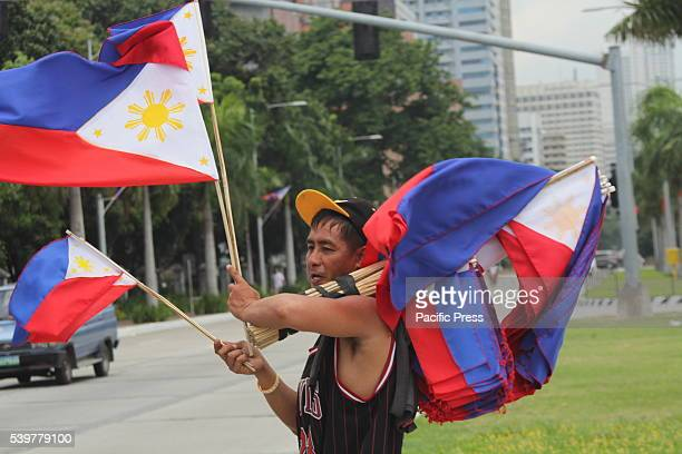 PARK MANILA NCR PHILIPPINES Flag vendor in Luneta Park Yearly on the 12th of June Philippines honor the declaration of independence from Spanish...