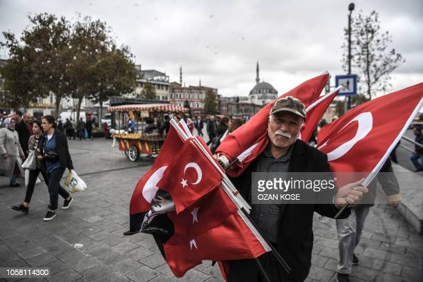 Flag vendor sells Turkish natinal flags and portrait flags of Mustafa Kemal Ataturk, founder of modern Turkey, near the New Mosque area in Istanbul's...