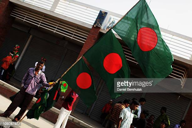 A flag vendor waits for customers prior to the start of the opening game of the ICC Cricket World Cup between Bangladesh and India at the...