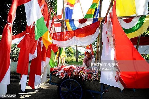 A flag vendors waits for customers during the Indonesian 69th Independence Day Anniversary on August 17 2014 in Surabaya Indonesia Indonesia became...