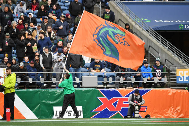 A flag waver performs during the XFL game between the Dallas Renegades and the Seattle Dragons at CenturyLink Field on February 22 2020 in Seattle...