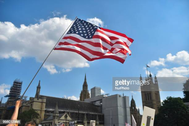 A US flag waves as a protest takes place in Central London against the US President Donald Trumps visit to the UK including a giant inflatable Baby...