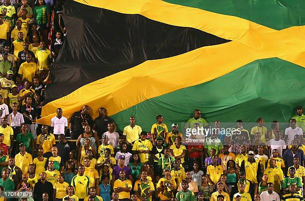 A flag waves in the crowd as USA takes on Jamaica in the FIFA 2014 World Cup Qualifier at National Stadium on June 7 2013 in Kingston Jamaica