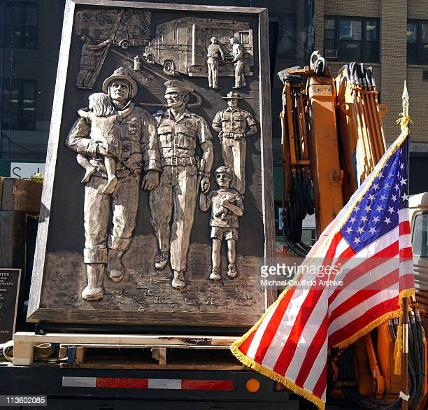 A US flag waves near a bronze memorial sitting atop a flatbed truck in New York City Wednesday Sept 19 2001 The State of Missouri commissioned the...