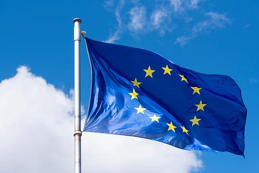 EU Flag waving against blue Sky 954683304