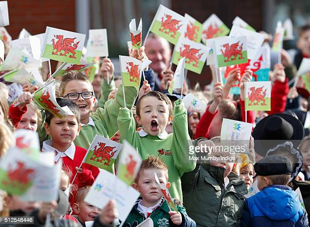 Flag waving schoolchildren await the arrival of Prince Charles, Prince of Wales for a visit to Stebonheath Primary School during a day of engagements...