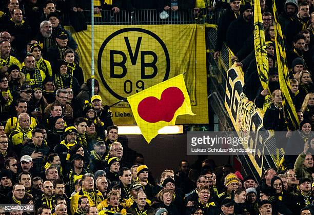 A flag with a heart is seen in front of the emblem of Dortmund during the Bundesliga match between Borussia Dortmund and Bayern Muenchen at Signal...