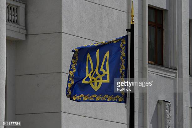 Flag with a Trident - Ukrainian State Arms - is seen waving near the Presidential Office building in Kyiv, Ukraine.