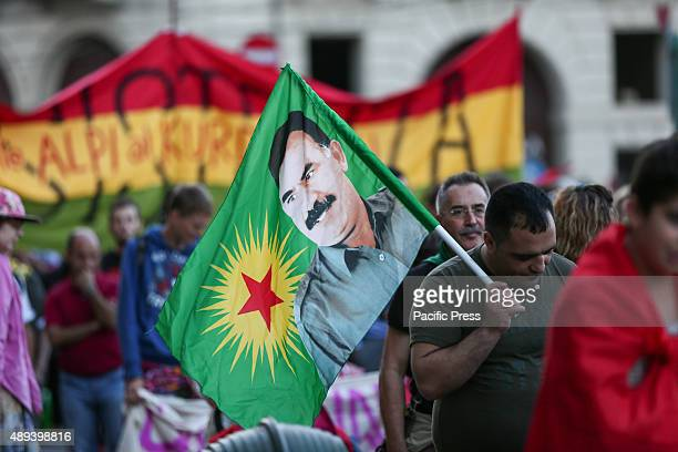 A flag with Abdullah Ocalan's face leader of the PKK Kurdistan Workers Party that is currently considered as a terrorist organization Hundreds of...
