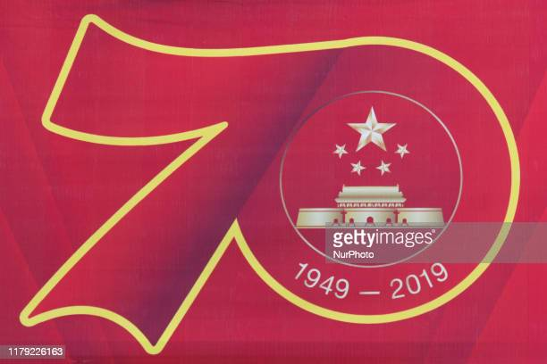 Flag with an image of the 70th anniversary of the People's Republic of China, seen in the center of Qinzhou. On Friday, October 18 in Qinzhou,...