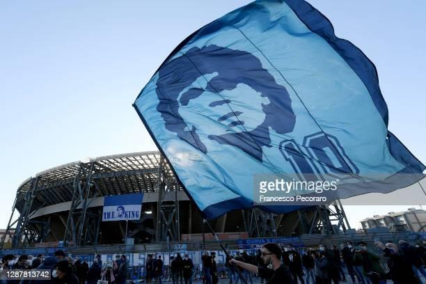 Flag with Diego Armando Maradona's face waving outside San Paolo Stadium on November 26, 2020 in Naples, Italy. Diego Armando Maradona died at 60...