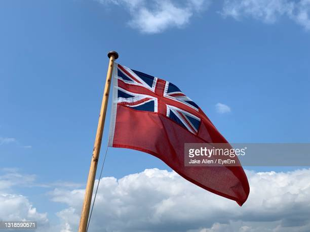 flag with sky backdrop - symbolism stock pictures, royalty-free photos & images