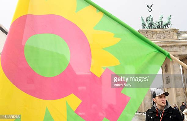 A flag with the female gender sign waves at an Equal Pay Day rally in front of the Brandenburg Gate on March 21 2013 in Berlin Germany The annual...