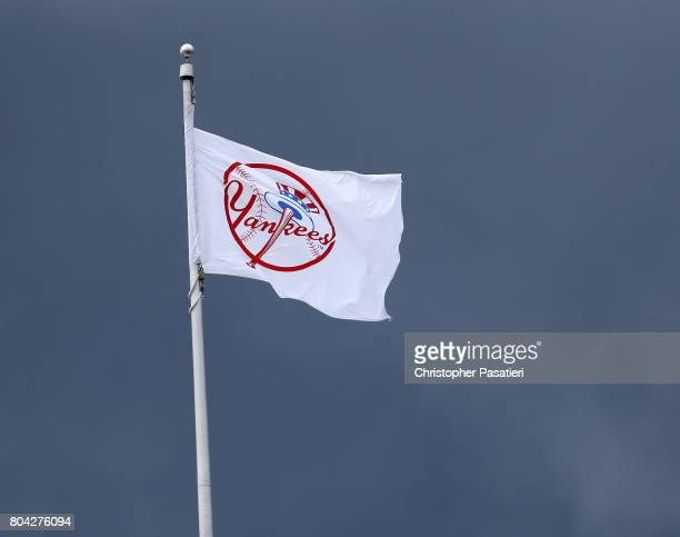 A flag with the logo of the New York Yankees waves as storm clouds approach during the game against the Texas Rangers on June 25 2017 at Yankee...