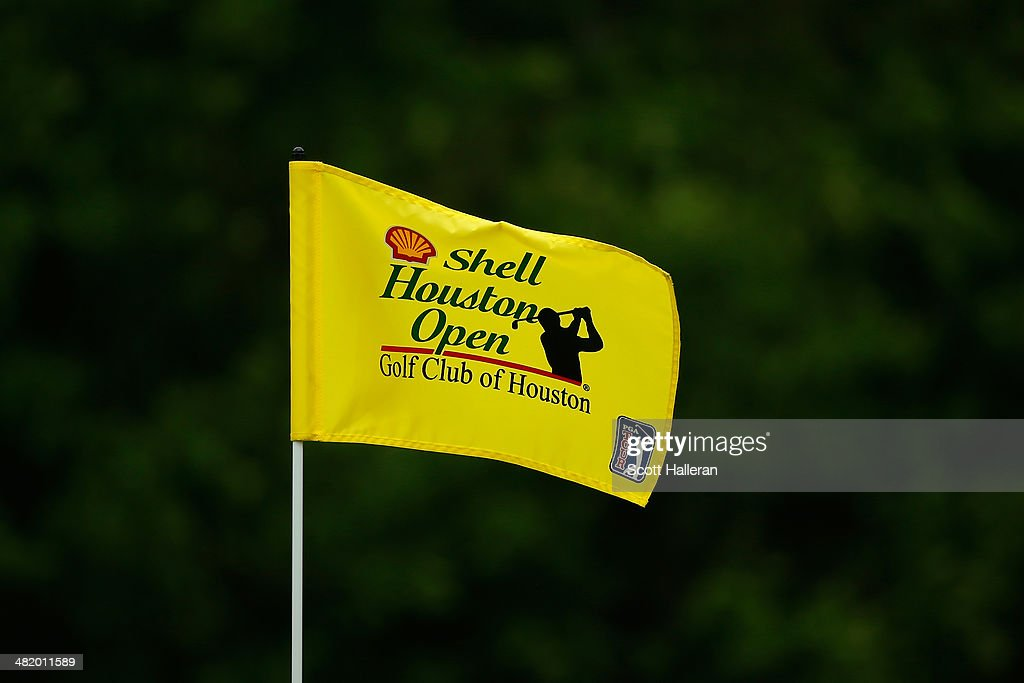 A flag with the Shell Houston Open Logo flaps in the wind on a green during the pro-am prior to the start of the Shell Houston Open at the Golf Club of Houston on April 2, 2014 in Humble, Texas.
