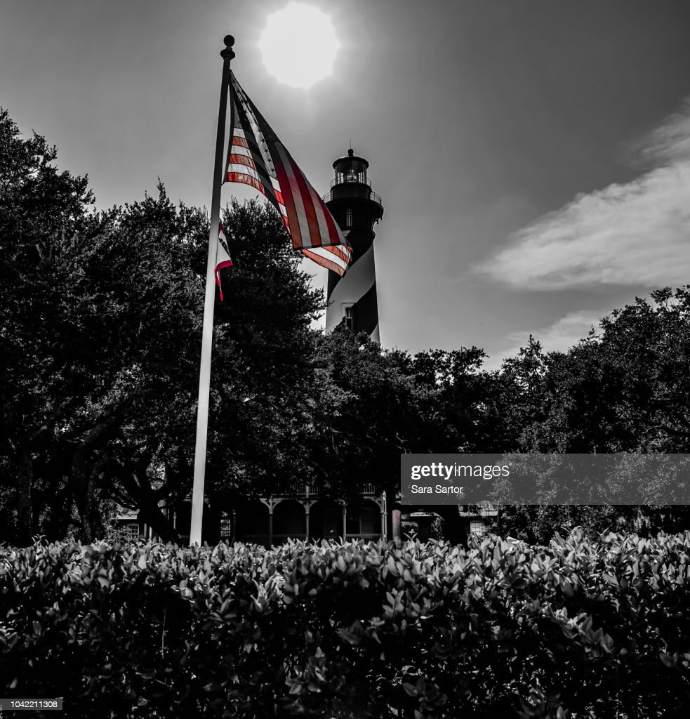 USA flag with the St Augustine Lighthouse : Stock Photo