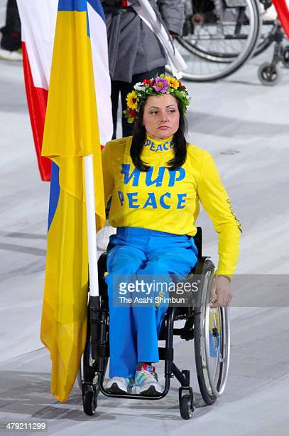 Flagbearer and Cross Country skier Lyudmyla Pavlenko of Ukraine enters the stadium during the Sochi 2014 Paralympic Winter Games Closing Ceremony at...